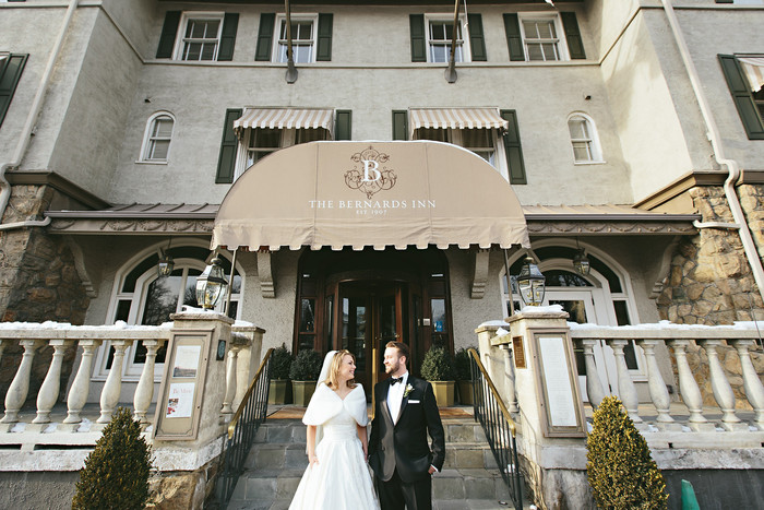 Couple in front of Bernads inn entrance by Bernards Inn in Bernardsville NJ