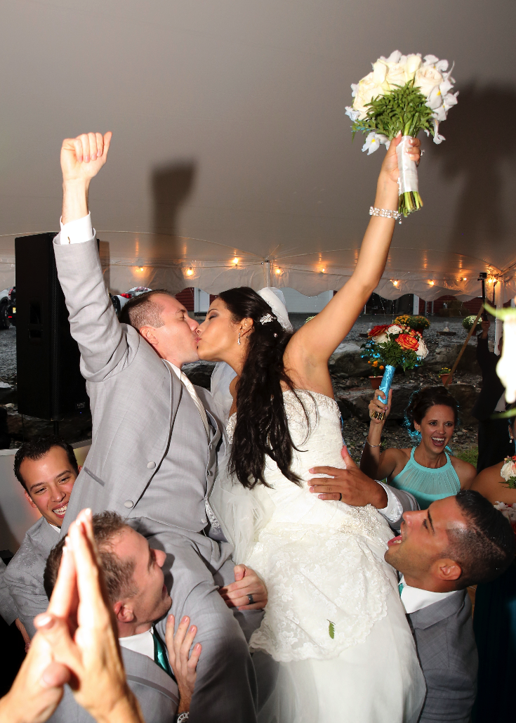 Bride and groom were swept off their feet by guests during their outdoor reception- Schohola, PA