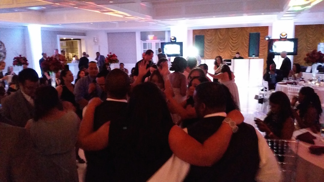 Lively Guests Pack the Dance Floor All Night Long in Honor of the Love Between These Newlyweds – Villa Venezia in Middletown, NY.