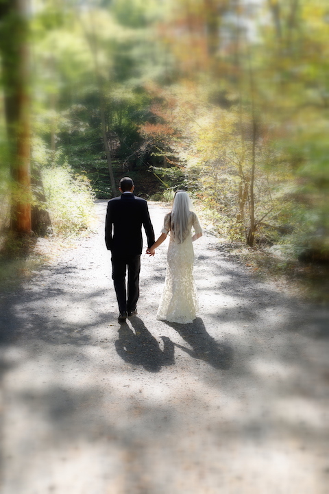 Bride and Groom Take a Moment For Special Sunlit Walk As Husband and Wife- Fire and Oak in Montvale, NJ.