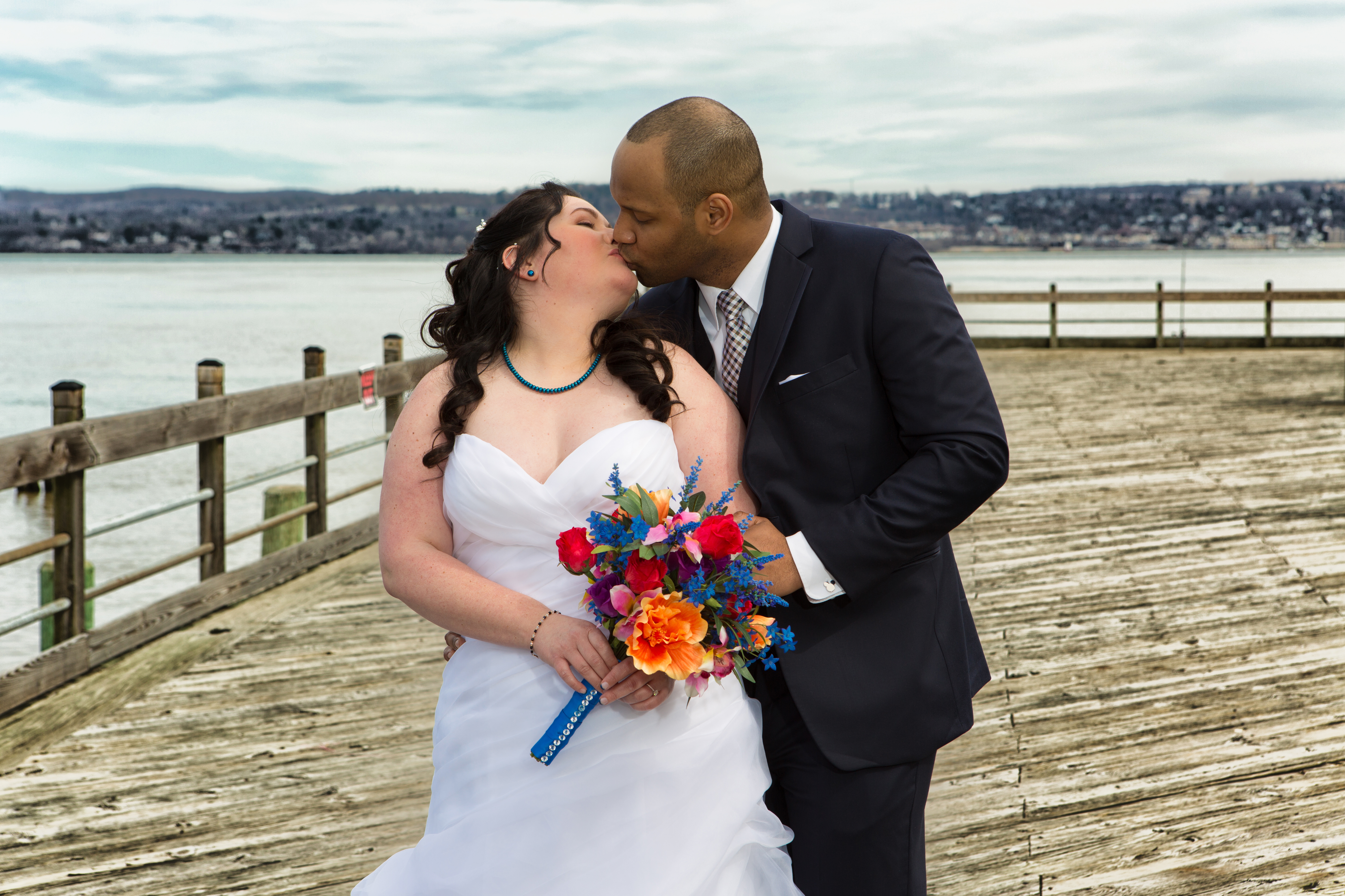 With Beautiful Spring Flowers in Hand, NY Bride Poses With Groom For Stunning Wedding Photos On the Water- The Nyack Seaport in Nyack, NY