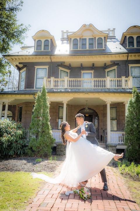 With Spring Blooming Around Them, NJ Groom Dips His Stunning Bride in Front of Beautiful Historic Home- The Oakside Mansion in Bloomfield, NJ